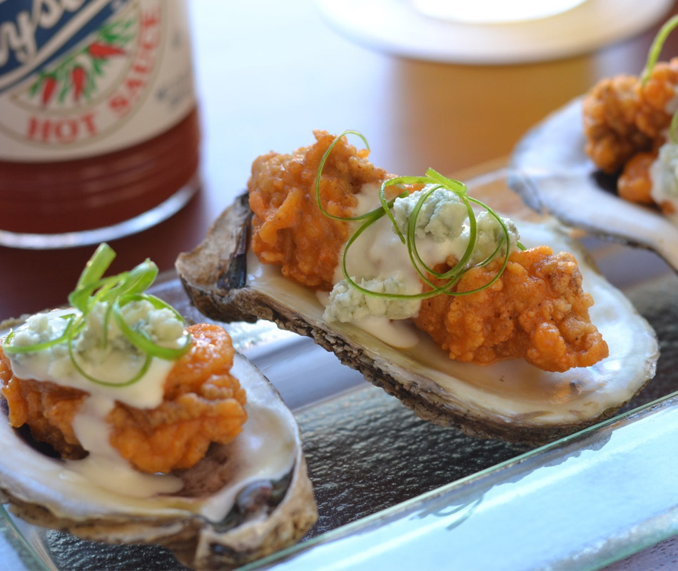 Red Fish Grill bbq oysters with a bottle of Crystal hot sauce