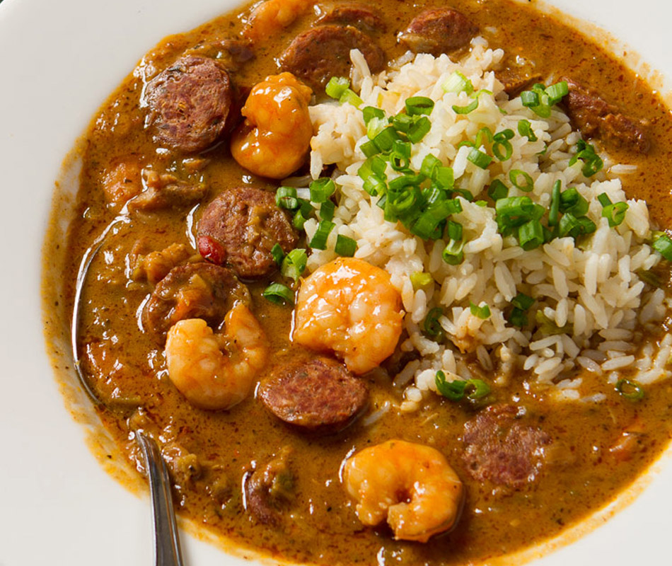 Alligator Sausage and Seafood Gumbo with spoon in bowl