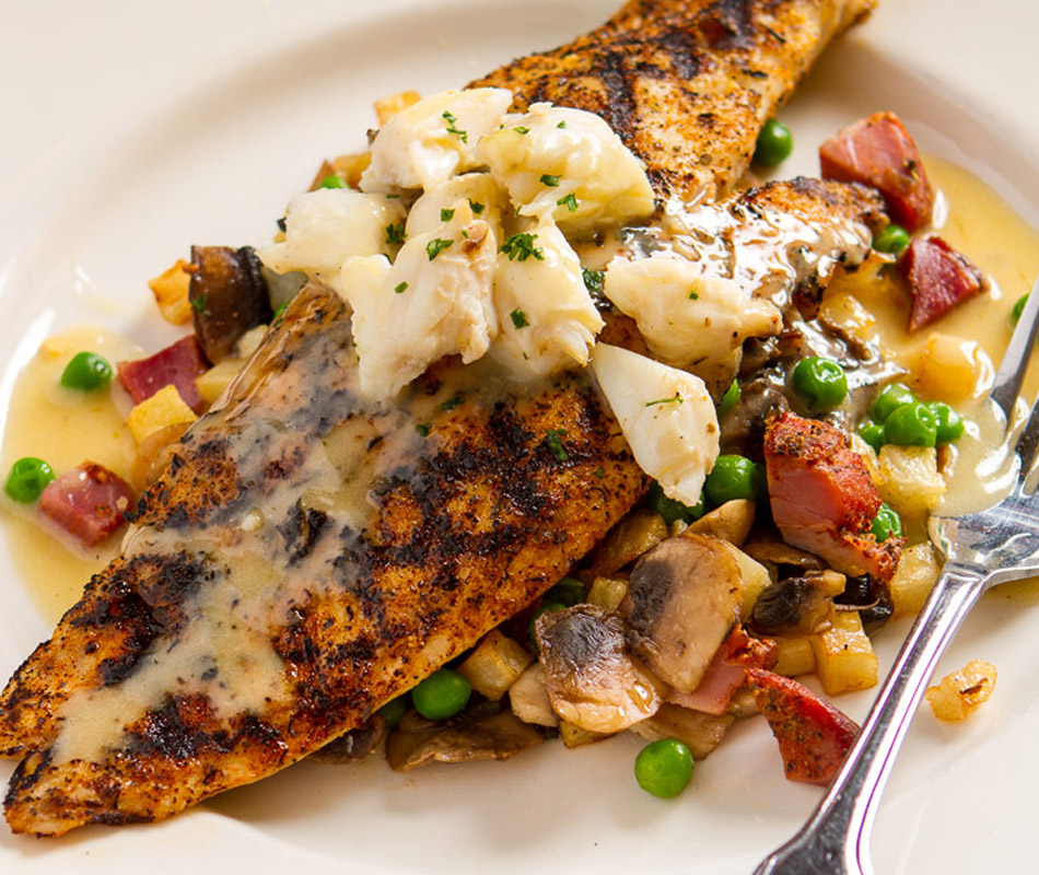 Hickory Grilled Red Fish pictured on dinner table with fork