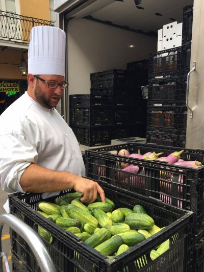 Chef Austin Selecting Fresh Covey Rise Farms Cucumbers
