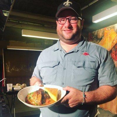 Chef Austin proudly serves his Redfish Courtbouillon at Jazz Fest
