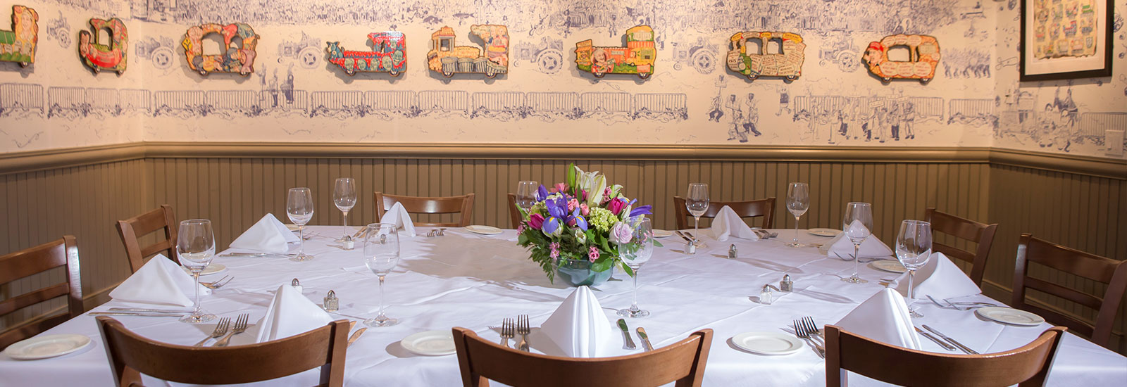 Private party room with buffet at Red Fish Grill set up for a Mardi Gras themed social event.